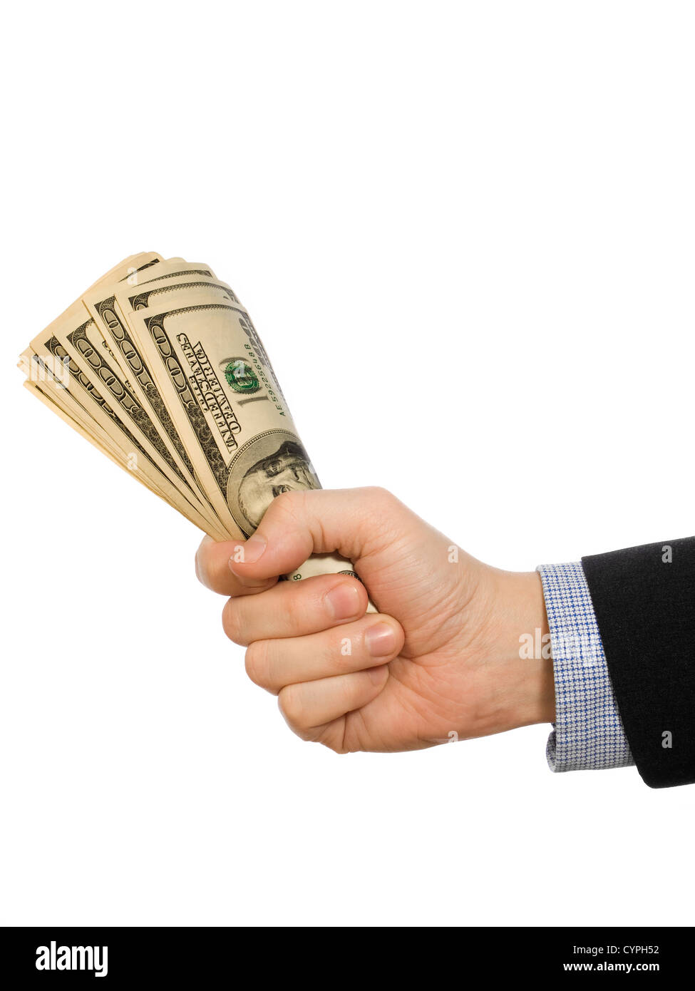 A man's hand holding a handful of dollars. - Stock Image