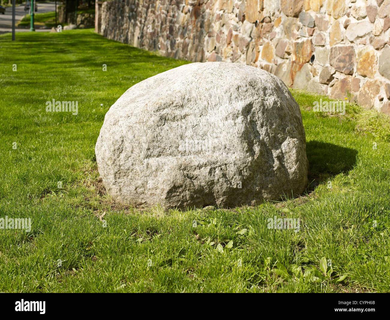 Big rock and grass - Stock Image