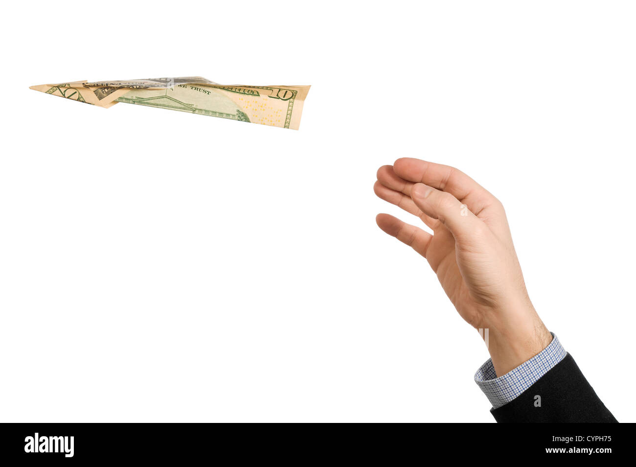 A man's hand throwing a paper plane made of a ten dollar bill. - Stock Image