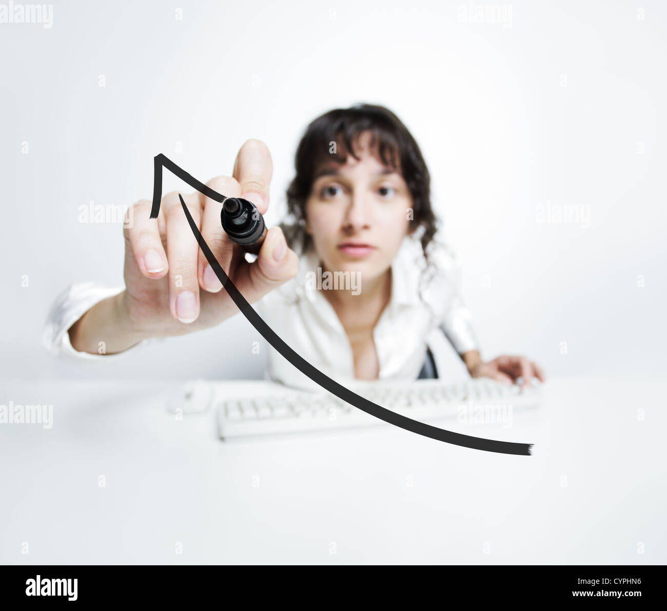 concentrated woman with a pen drawing a uptrend chart on screen - Stock Image