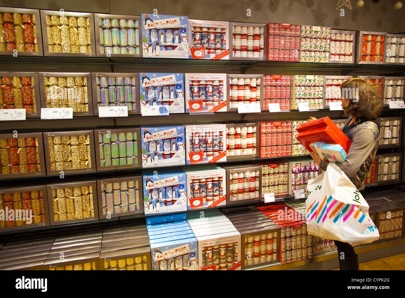 A Lady Looking At Boxes Of Christmas Crackers In John Lewis Stock Photo Alamy