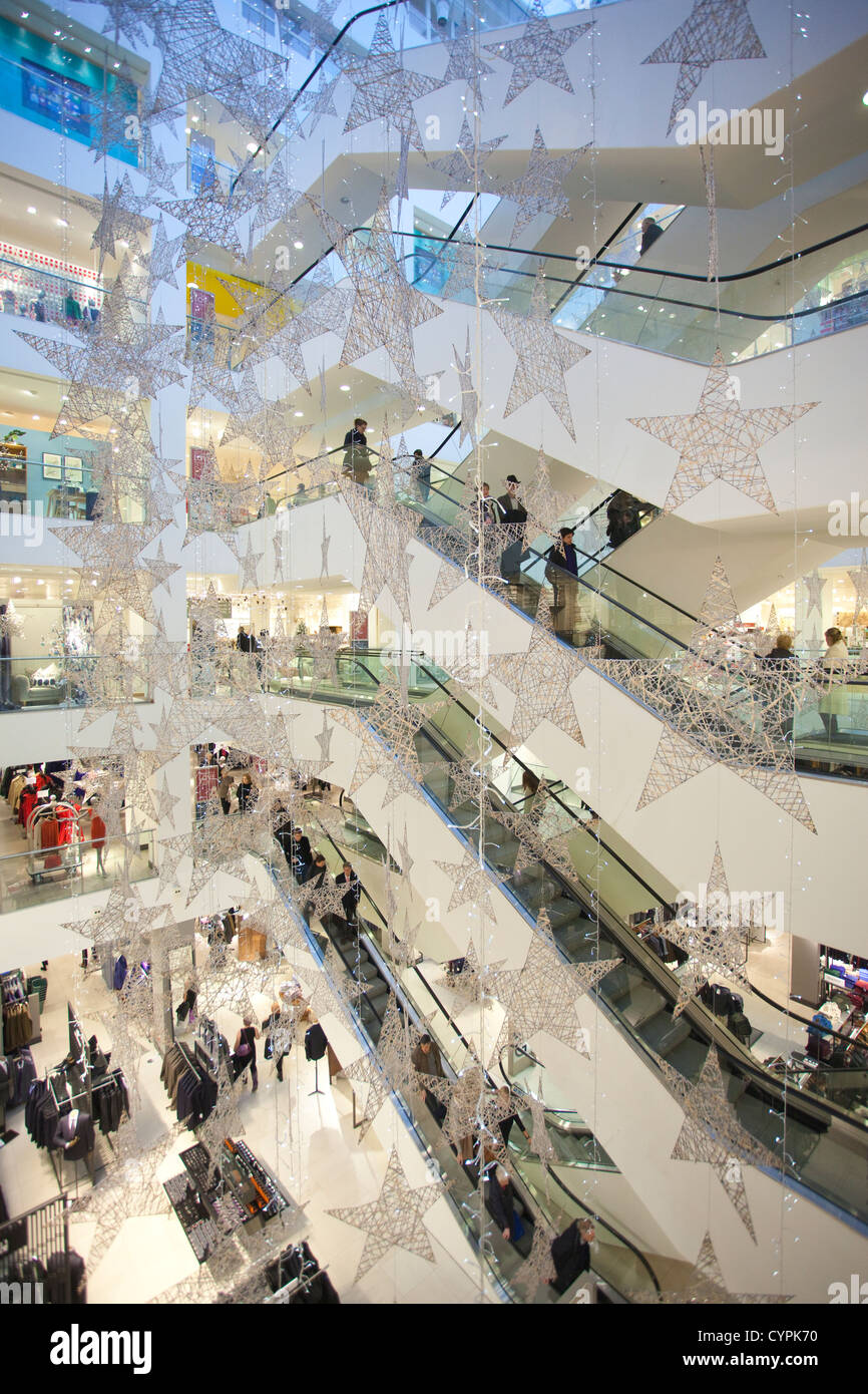 Christmas decorations in the main hall at John Lewis department store, Oxford Street, West End, London, England, - Stock Image