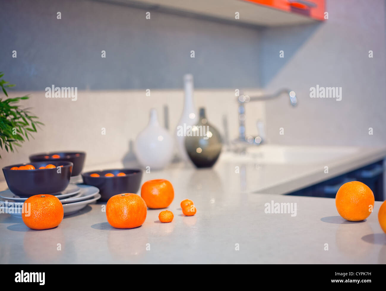 kitchen interior with fruits and dishes  on  countertop (beautiful Depth Of Field effect) - Stock Image