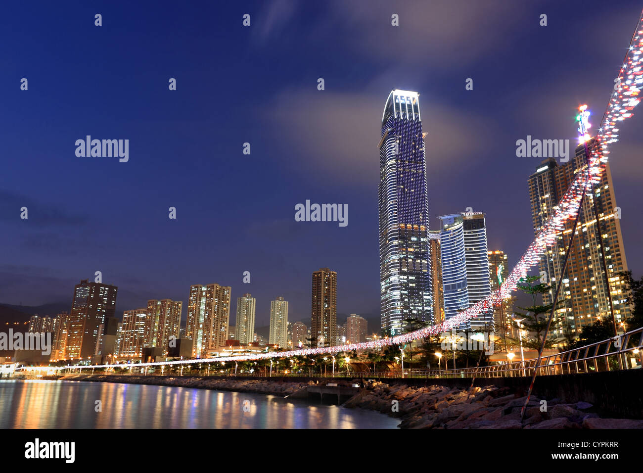 Hong Kong at night with highrise buildings - Stock Image