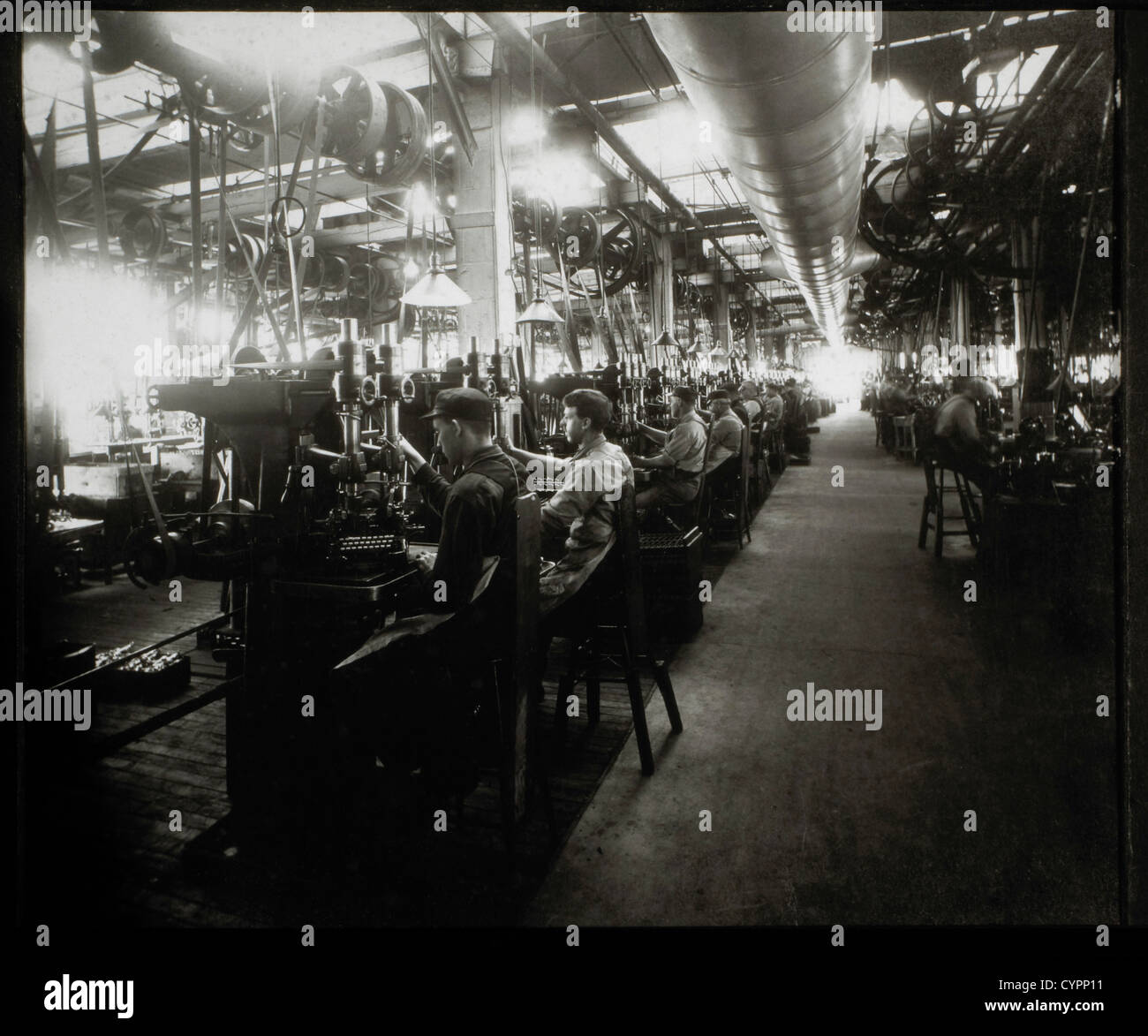 Workers in Typewriter Factory, Circa 1920 - Stock Image