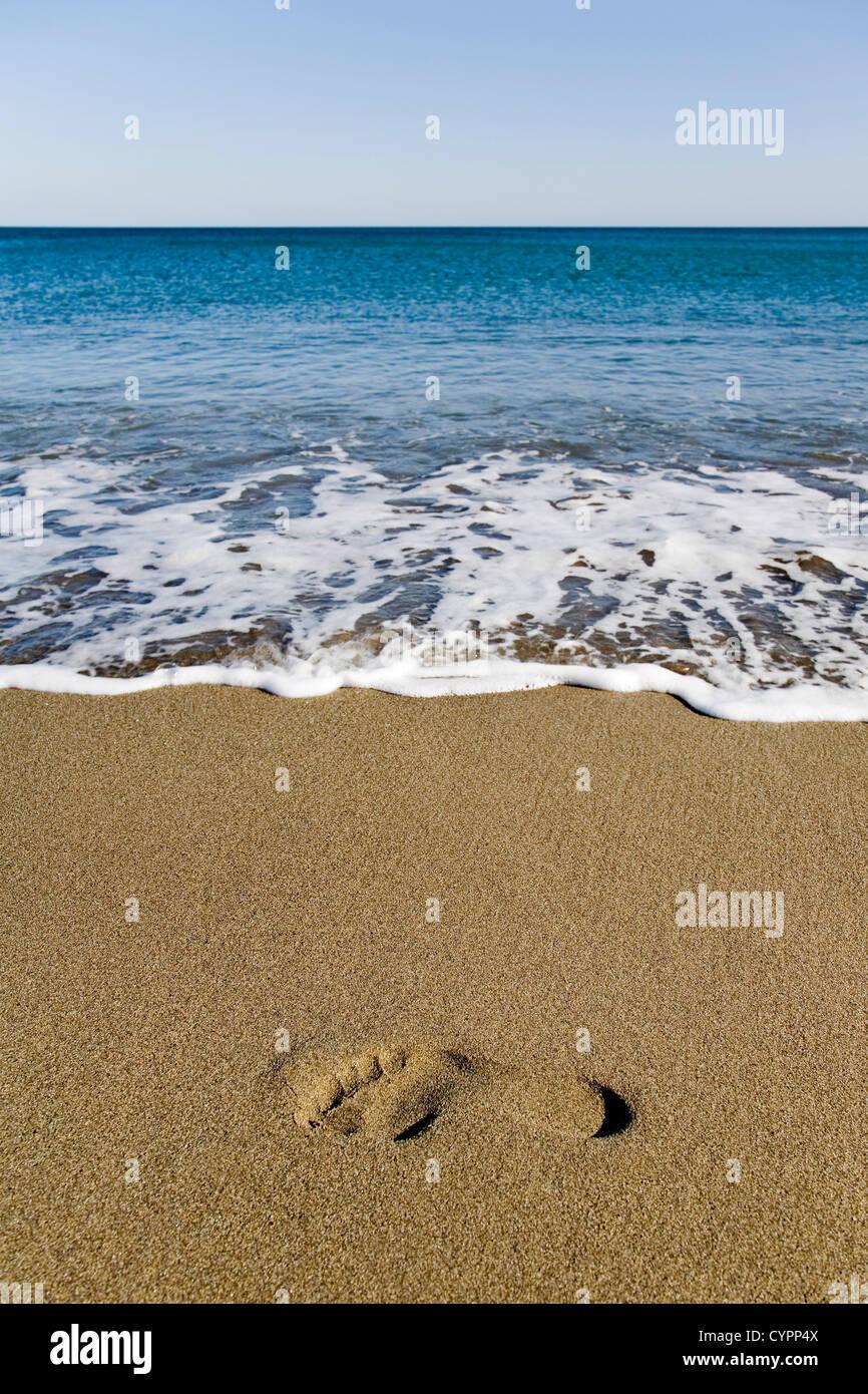 footprint on the beach and Mediterranean Sea Andalusia Spain pisada en la playa y mar mediterraneo andalucia españa - Stock Image