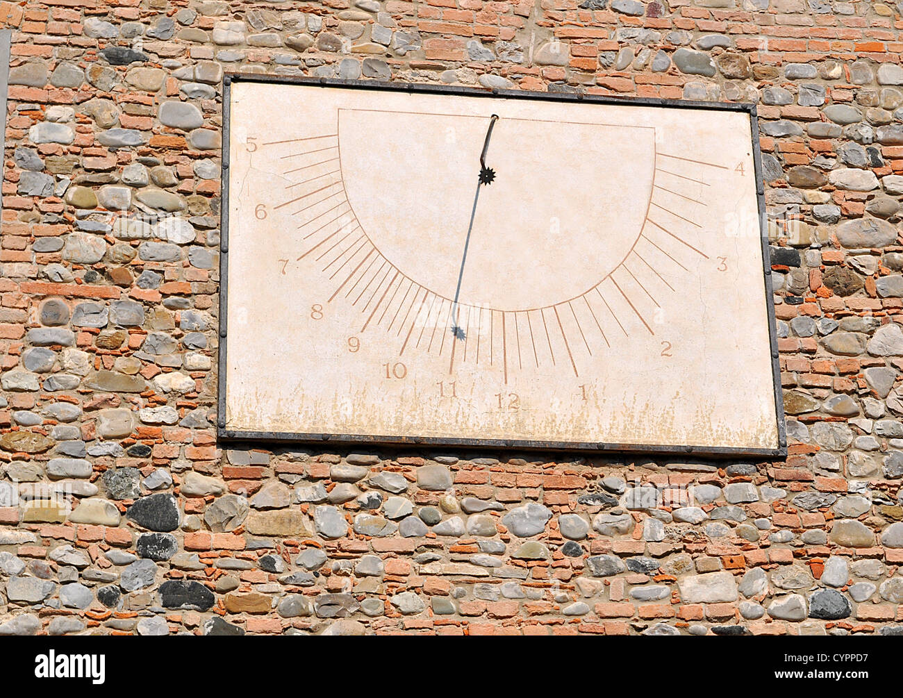 old sundial on a red bricks wall - Stock Image