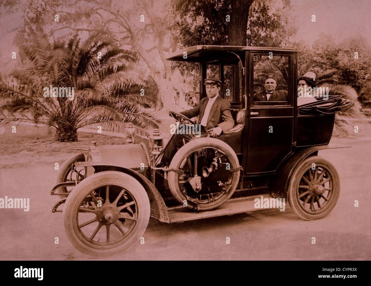 Couple and Driver in Automobile, USA, Circa 1908 - Stock Image
