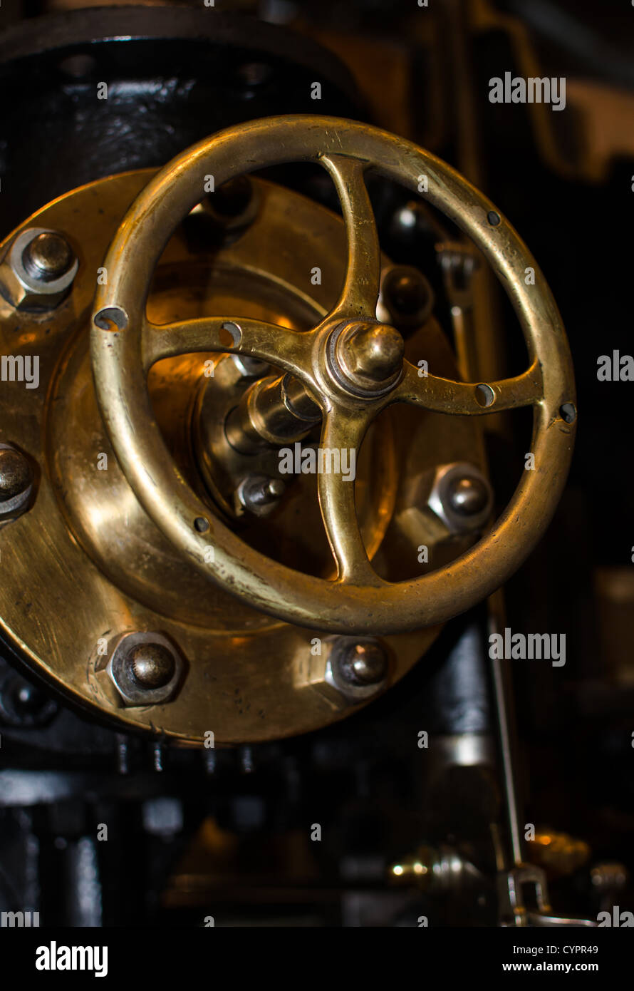 detail of an old machine, valve with control wheel Stock Photo
