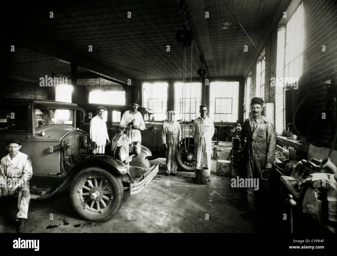 Group of Workers in Automotive Garage, USA, Circa 1920 - Stock Image