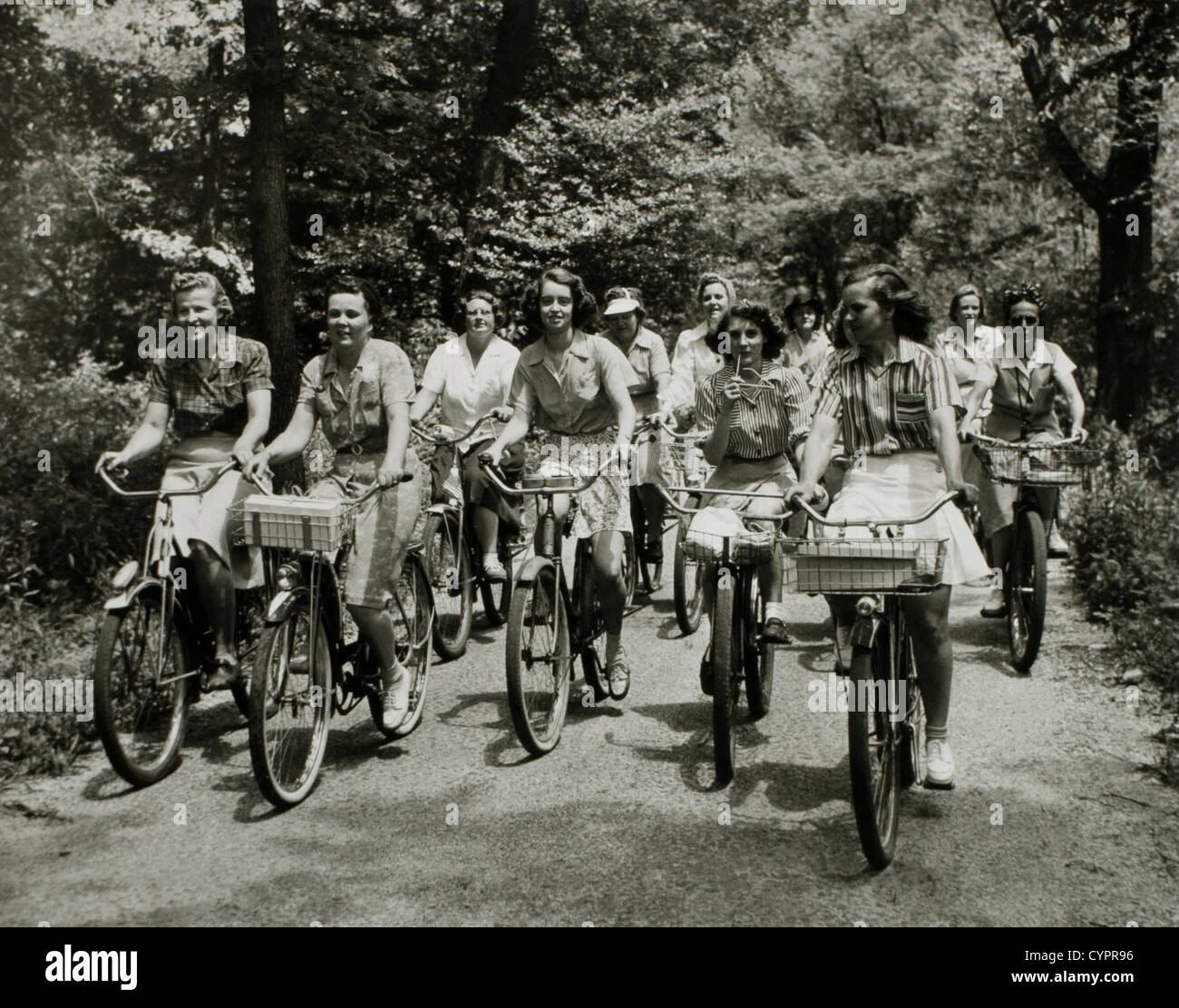 Group of Women Cyclists on Dirt Road, USA, 1950 - Stock Image