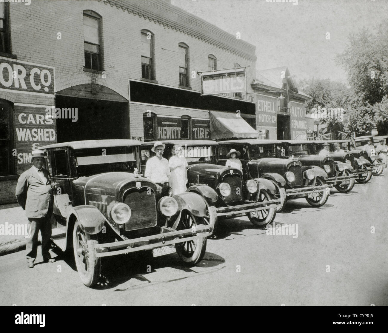 People Posed With Row of Automobiles, USA, 1921 - Stock Image
