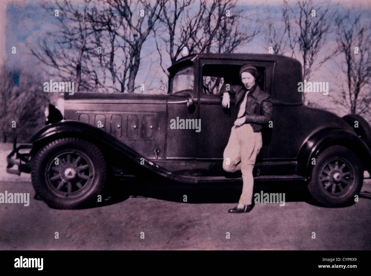 Woman Leaning on Car Door, USA, Circa 1930 - Stock Image