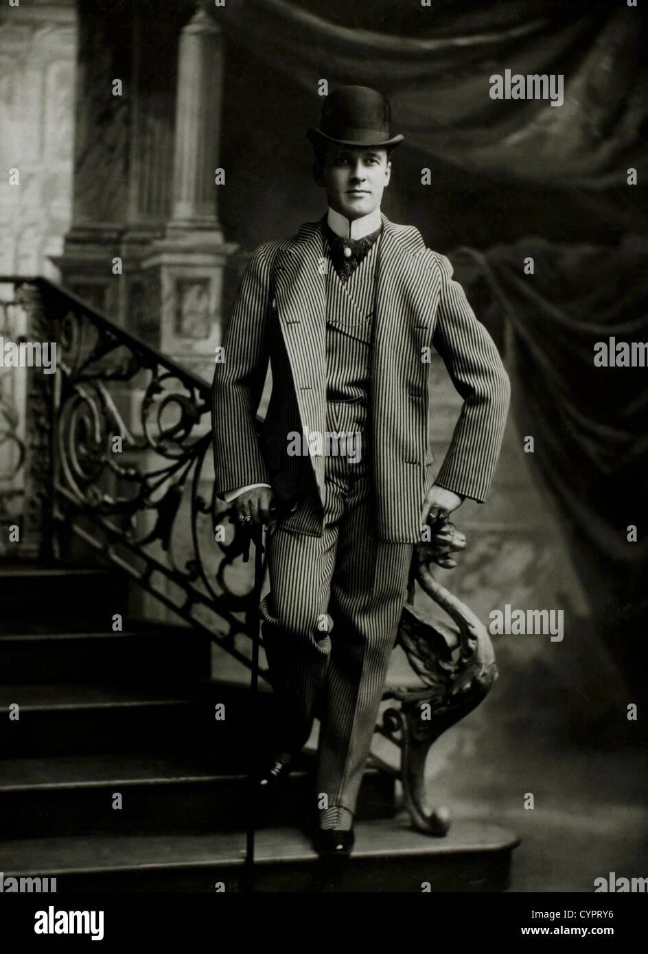 Dapper Man in Bowler Hat With Cane, Portrait, Circa 1900 - Stock Image