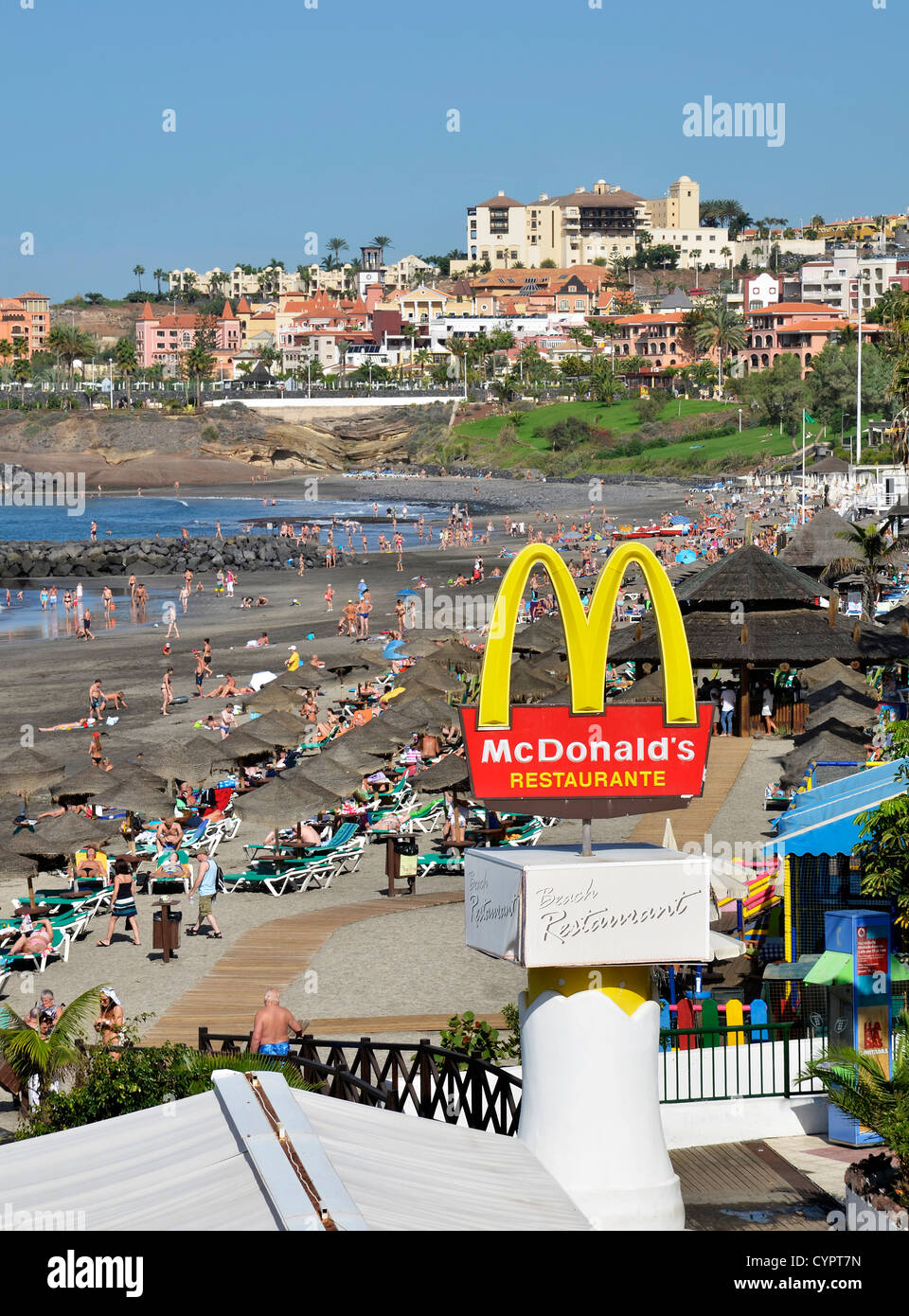 A Mcdonalds restaurant by the beach at Torviscas on the costa adeje in Tenerife, Canary Islands. - Stock Image