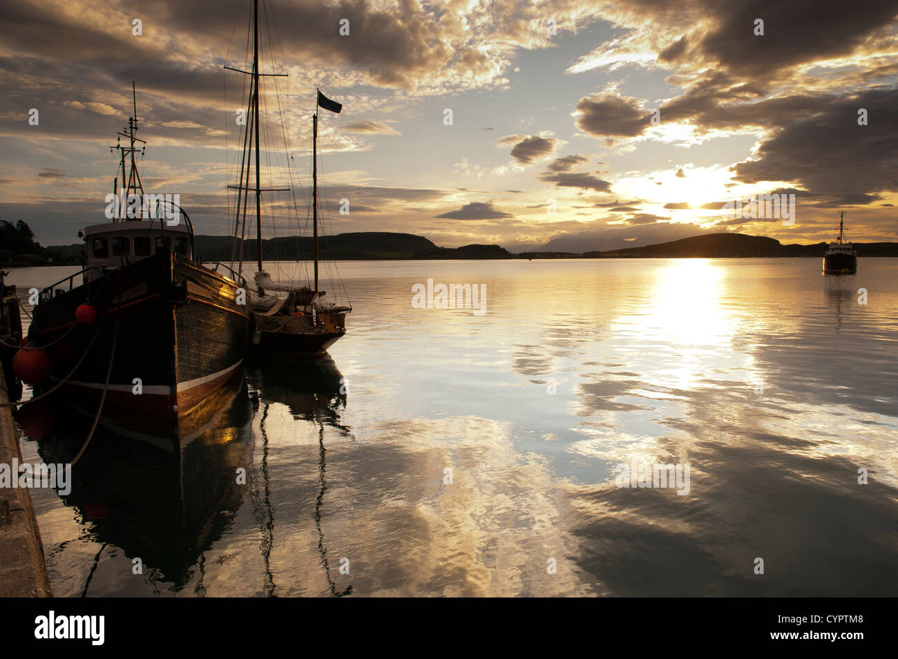 Sailboat in Oban Harbour on a summers evening. UK - Stock Image