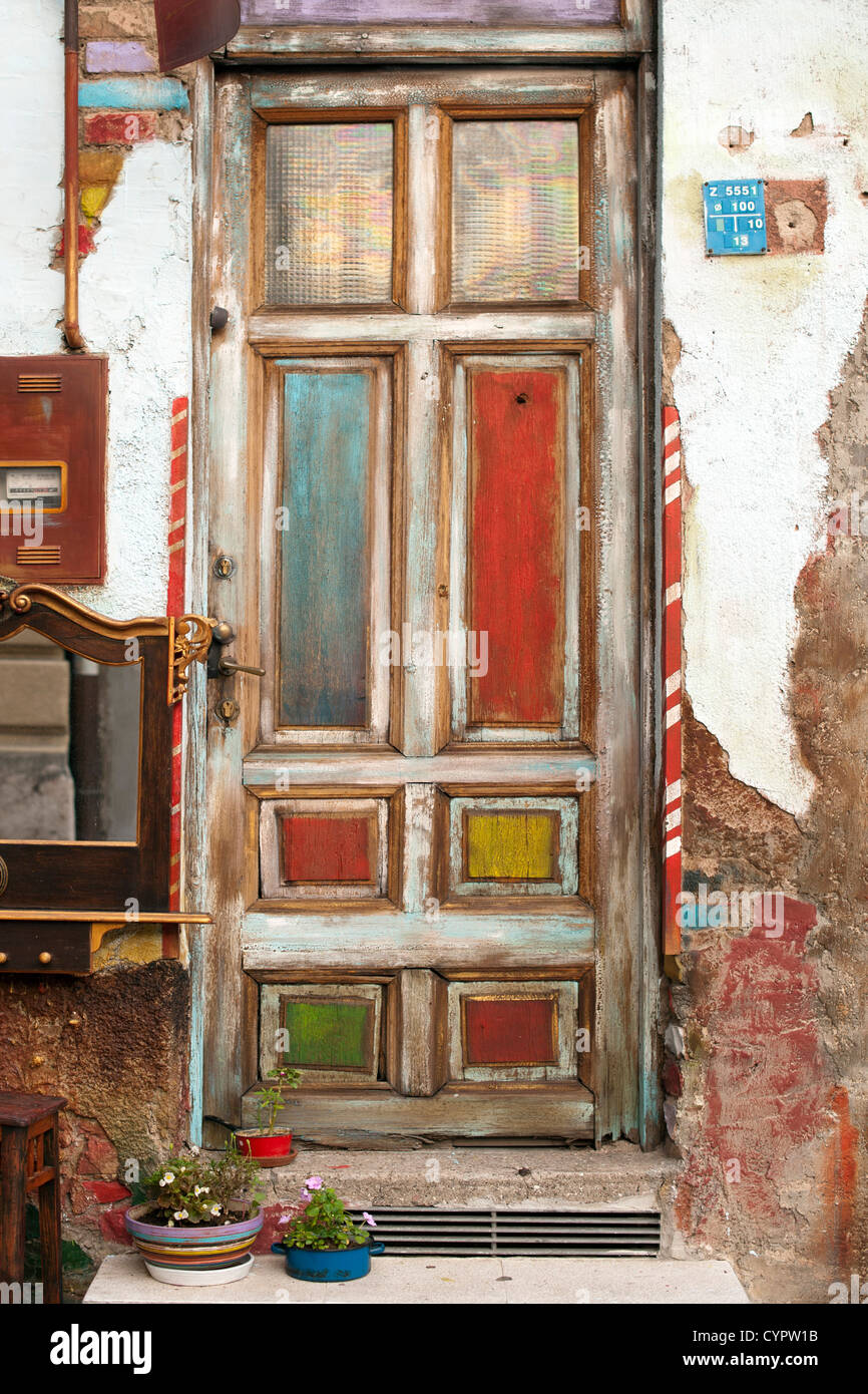 A colourful wooden door in a side street in Sarajevo. - Stock Image