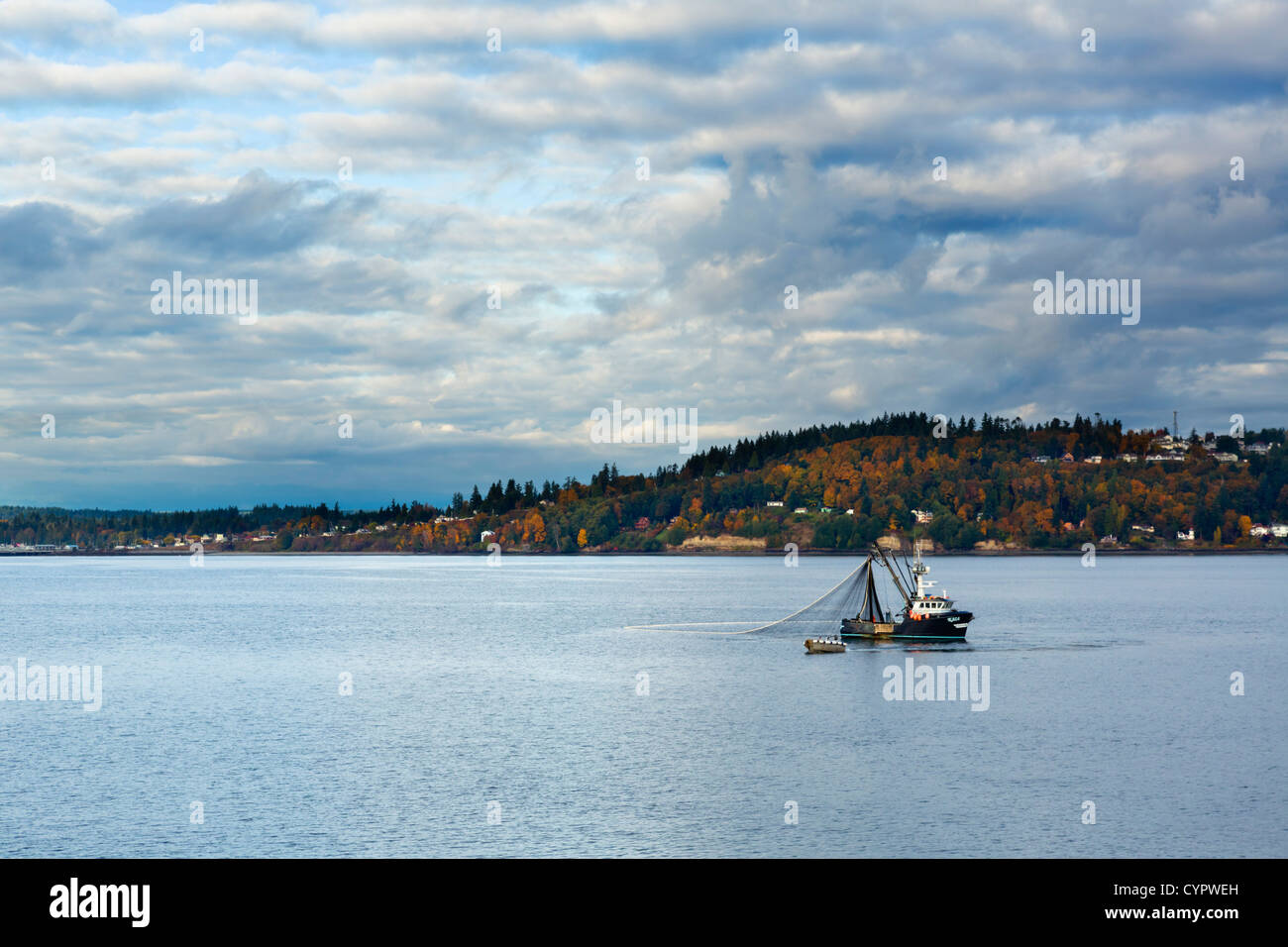 Fishing boat off Olympic Peninsula viewed from Washington State Ferry, Puget Sound between Edmonds and Kingston, - Stock Image