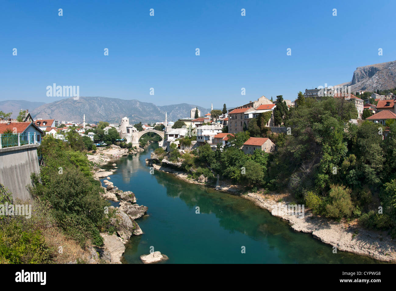 The village of Mostar and its famous Stari Most 'Old Bridge' over the Neretva River in Bosnia-Herzegovina. - Stock Image