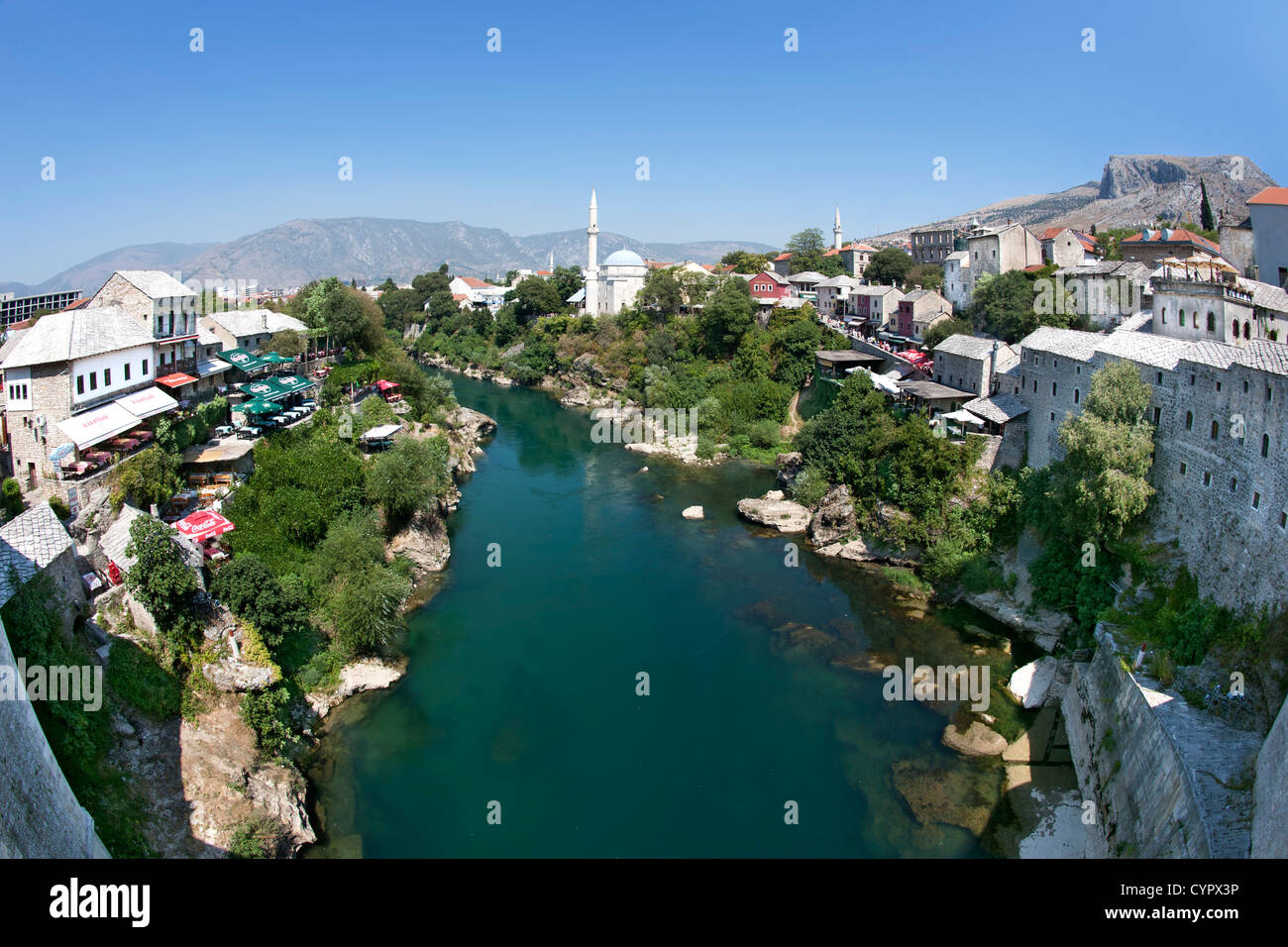 Mostar and the Neretva River in Bosnia and Herzegovina. Seen from the Old Bridge. - Stock Image