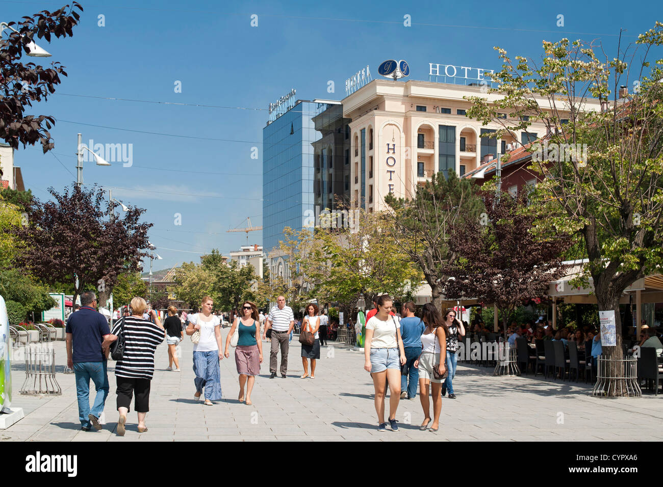 Pedestrians walking along Boulevard Nene Tereza in Pristina, the capital of the Republic of Kosovo. - Stock Image