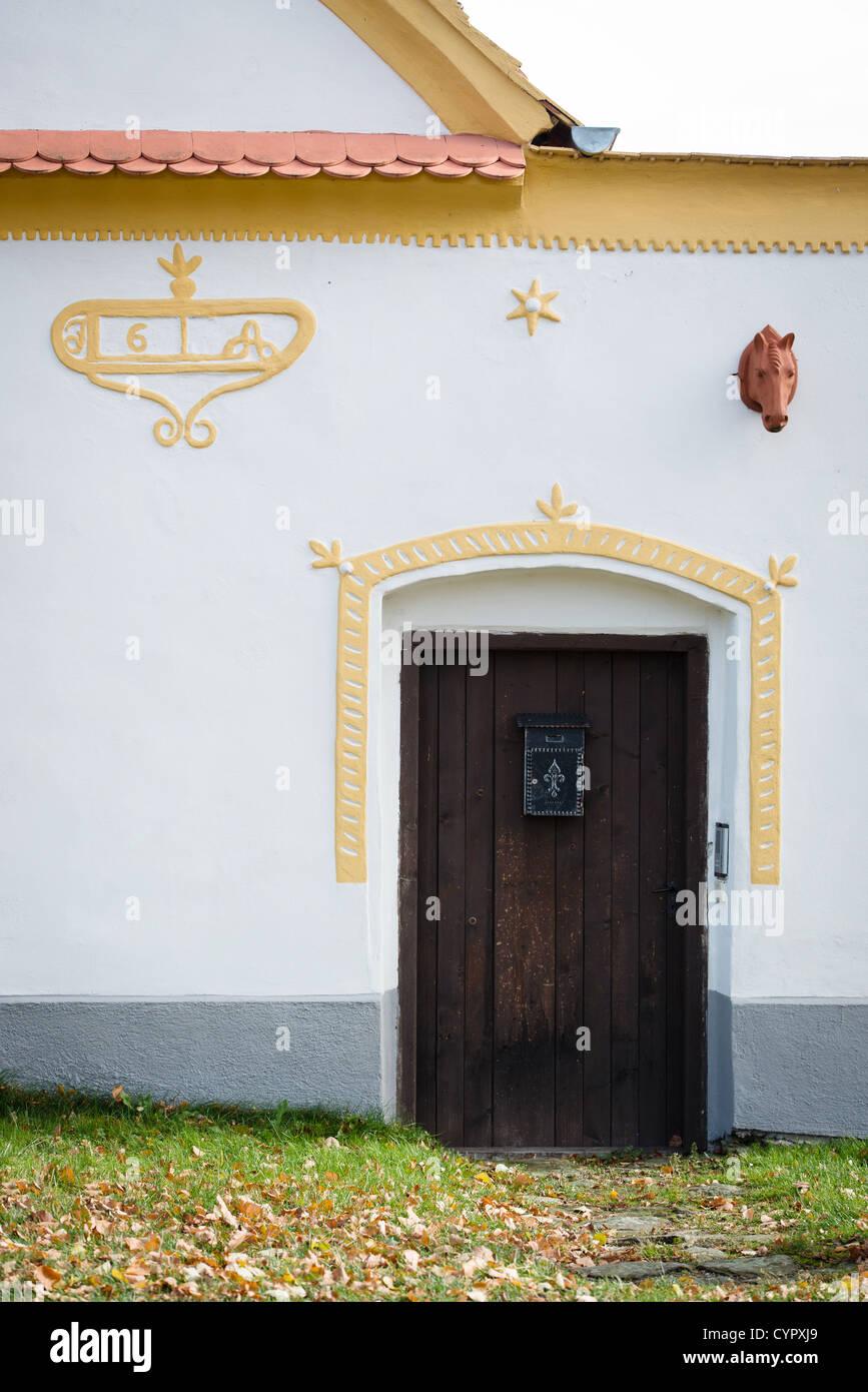 Holasovice - door to folk baroque farmhouse in Holasovice, UNESCO world heritage site, South Bohemia, Czech Republic - Stock Image