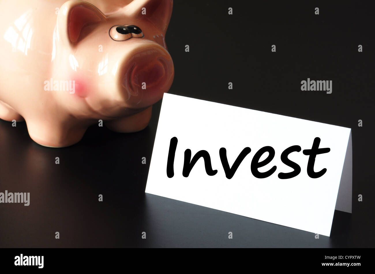 invest money or savings in your business future - Stock Image