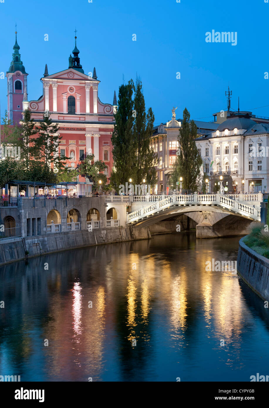 Franciscan Church of the Annunciation and the Triple Bridge over the Ljubljanica River in Ljubljana, the capital - Stock Image