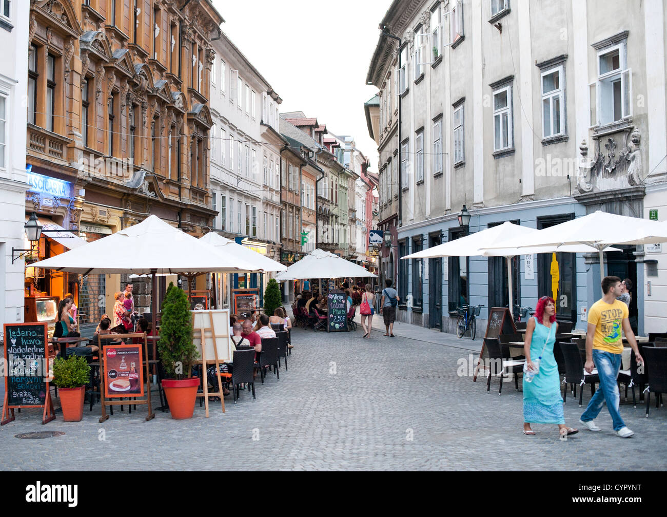 Sidewalk cafes in the old town in Ljubljana, the capital of Slovenia. - Stock Image