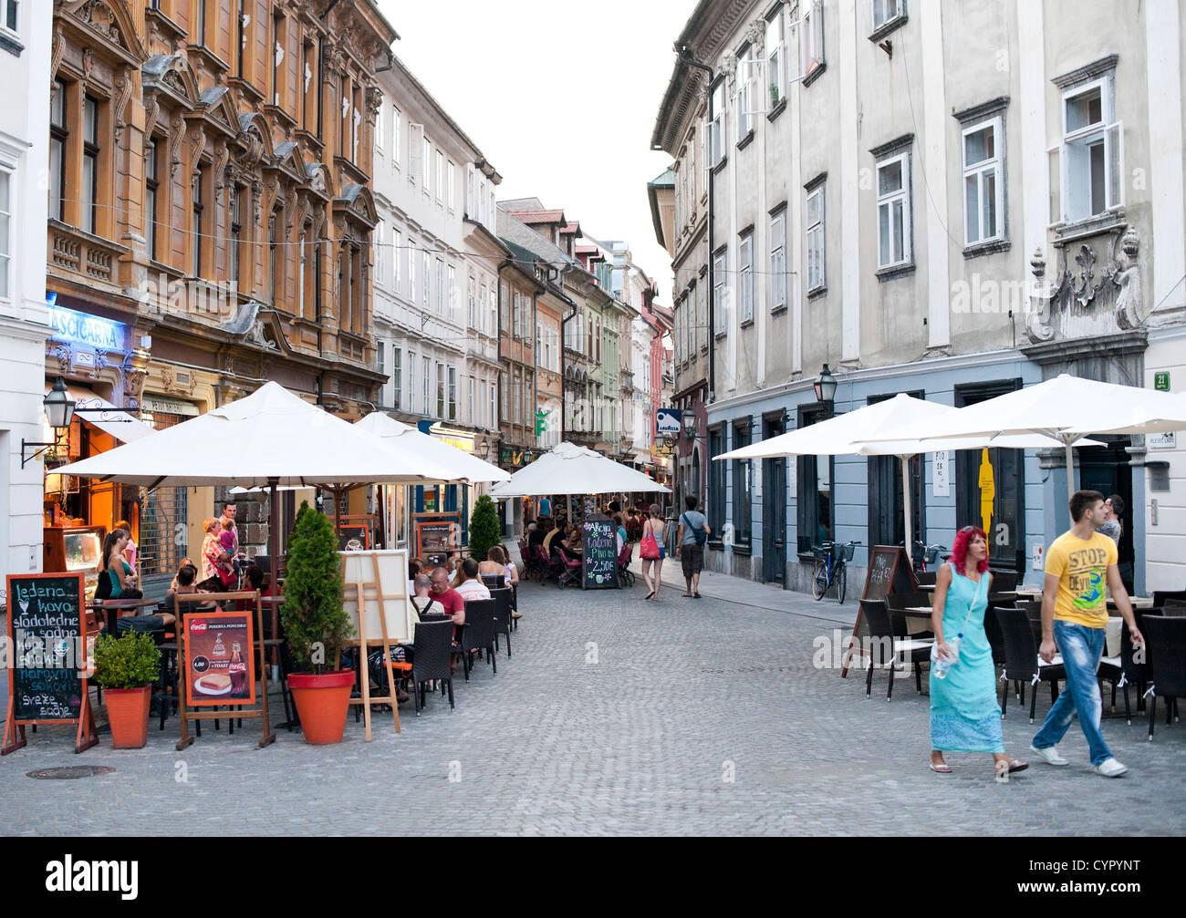 Sidewalk cafes in the old town in Ljubljana, the capital of Slovenia. - Stock Image