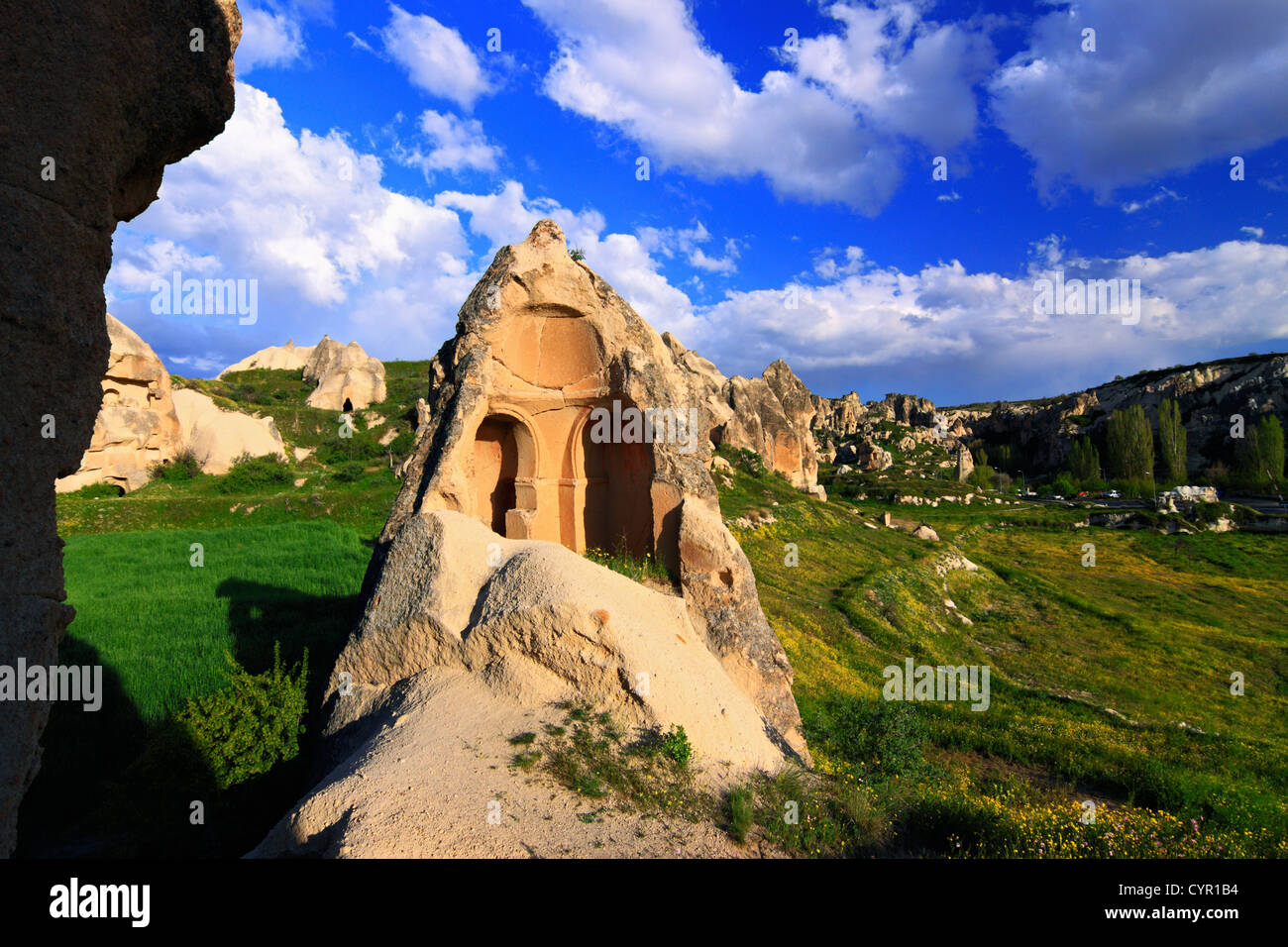 Cappadocia landscape with broken fairy chimney church in foreground , Turkey - Stock Image
