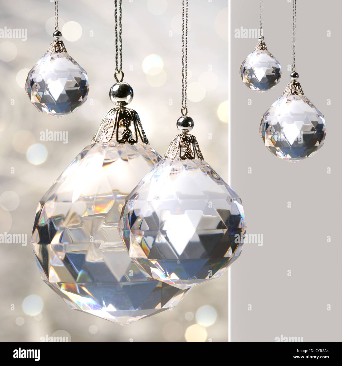 Crystal ornament hanging against shimmering background - Stock Image