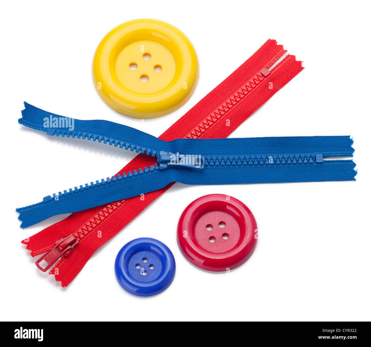 Three colored sewing buttons and two zippers. Isolated on white - Stock Image