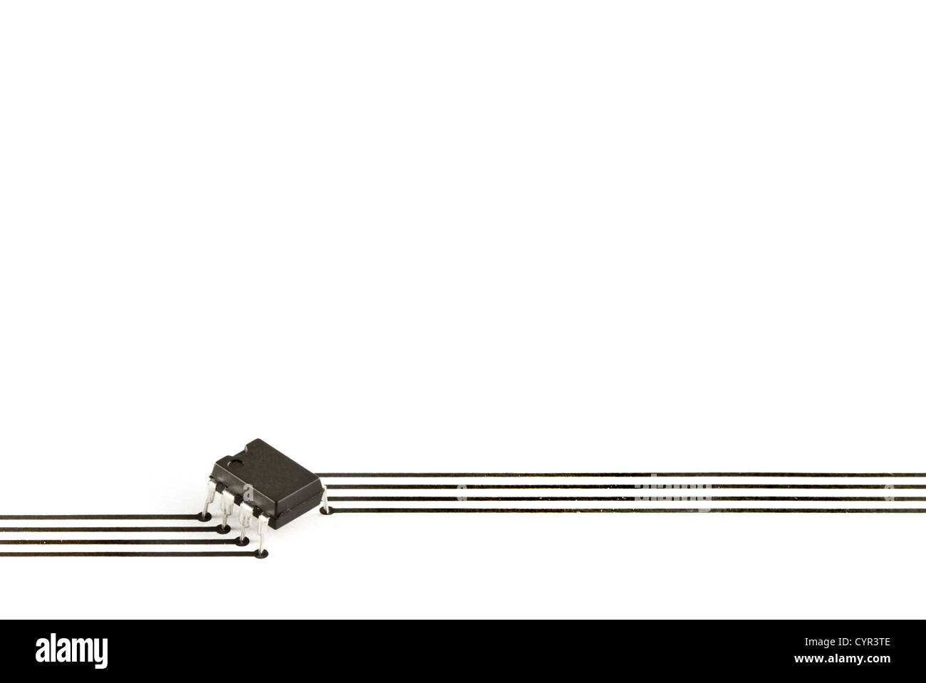 Design elements formed of an electronic chip and tracks printed on paper - Stock Image