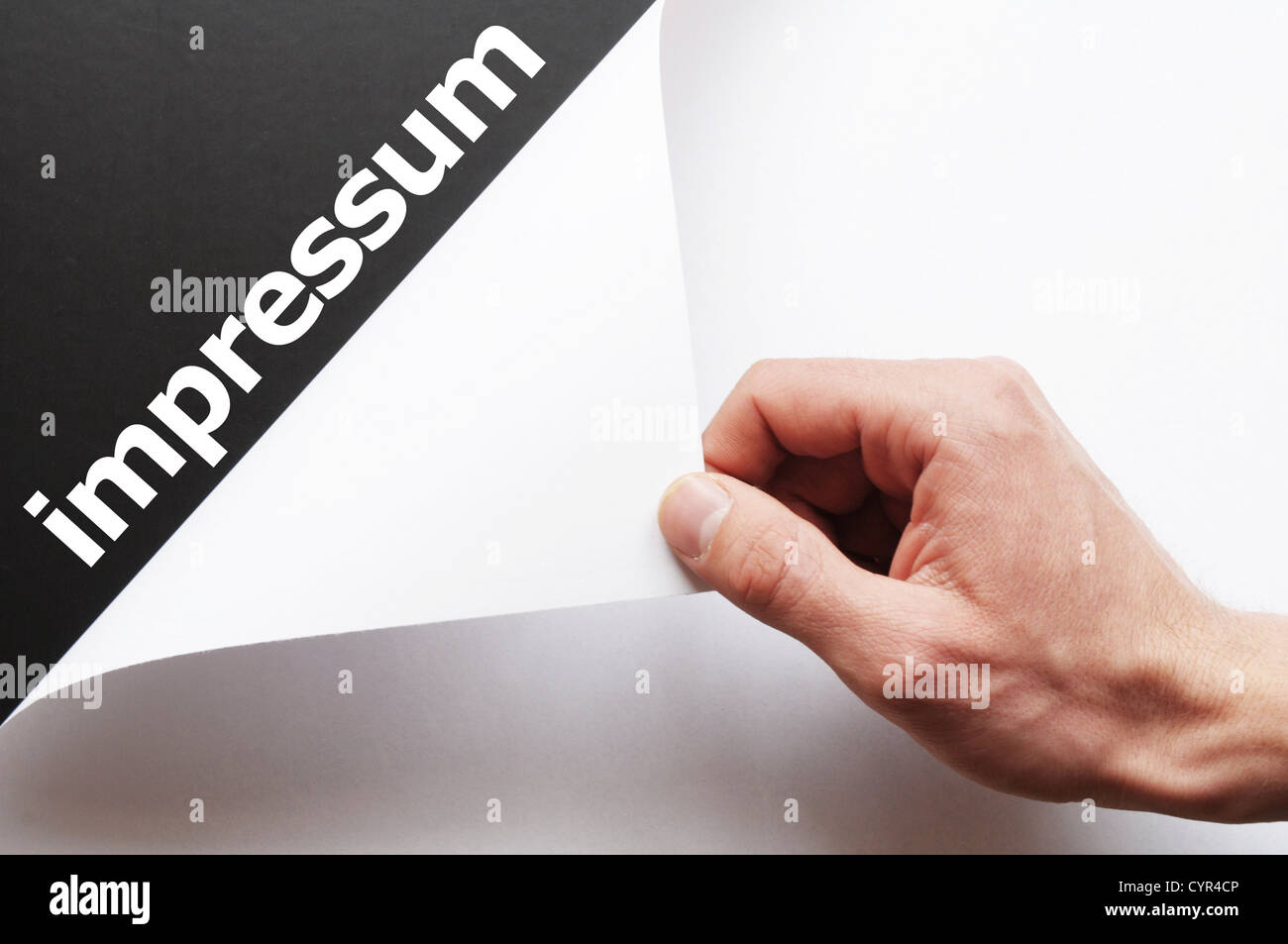 impressum concept with hand word and paper - Stock Image