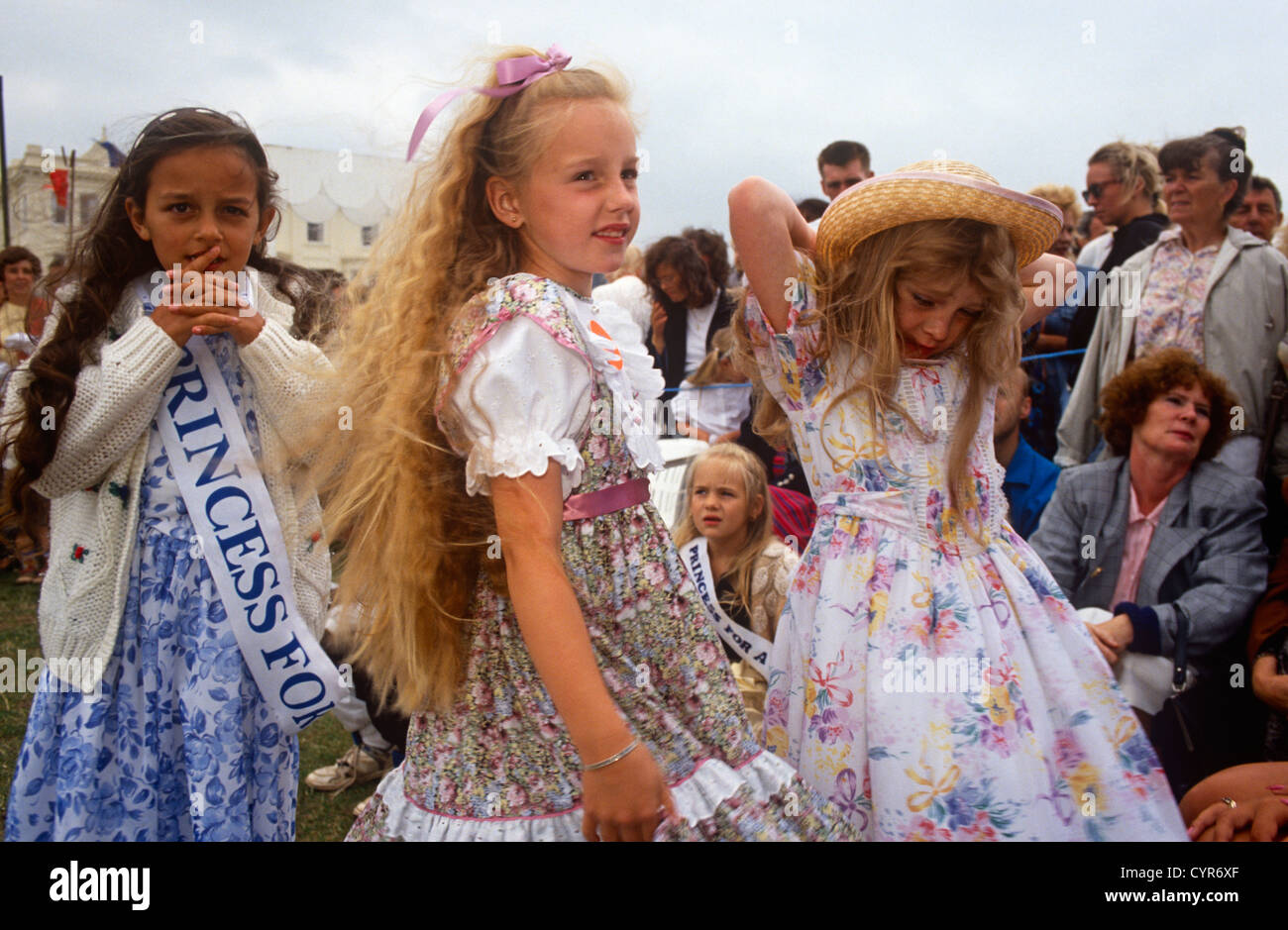 Carnival princesses with local crowds at the contest for Torbay's Carnival Princess and Queen during the seaside - Stock Image