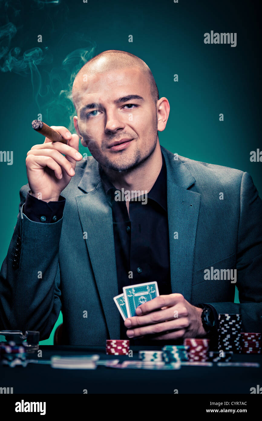 a young man playing poker - Stock Image