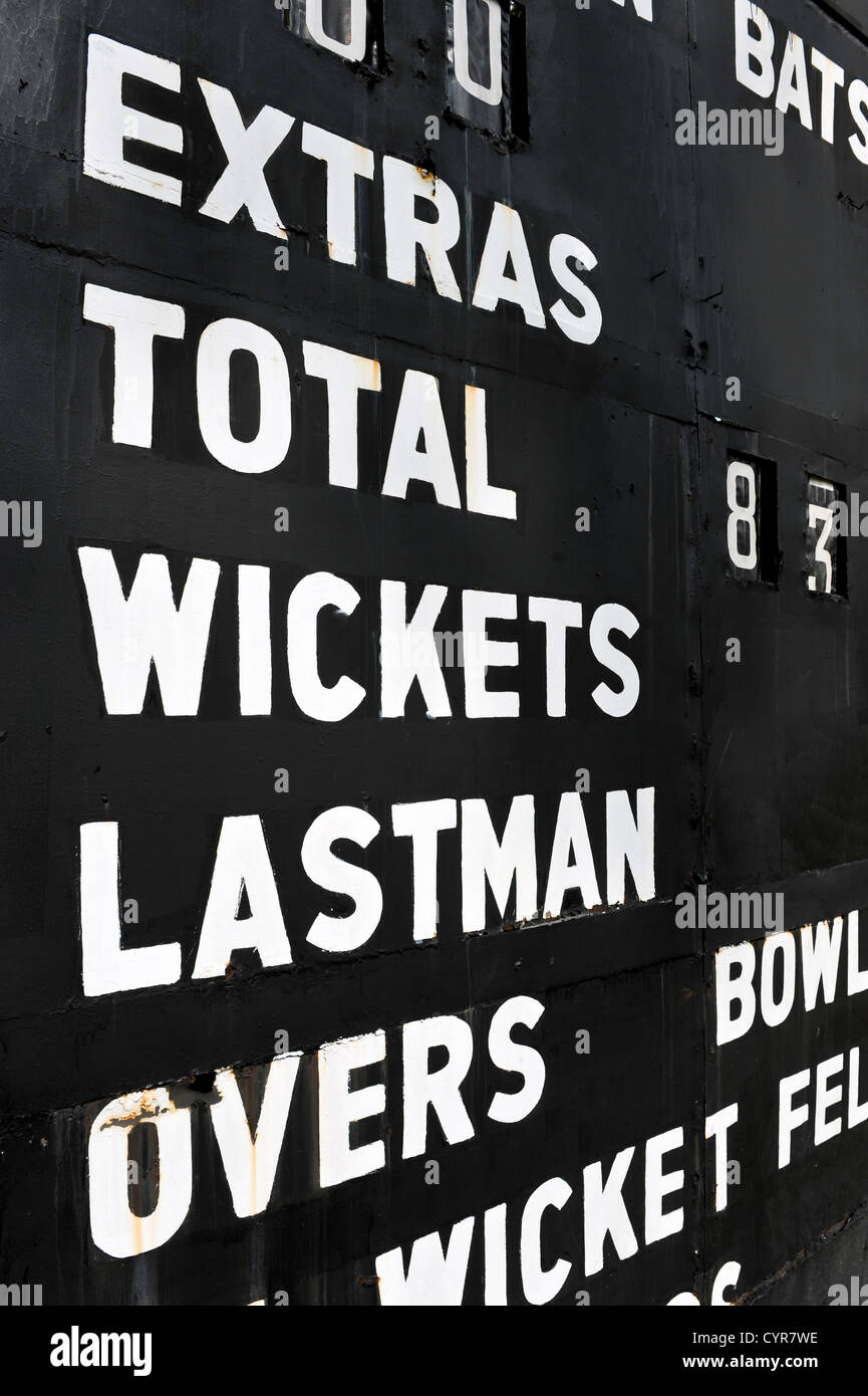 Old scoreboard used for the sport of cricket - Stock Image