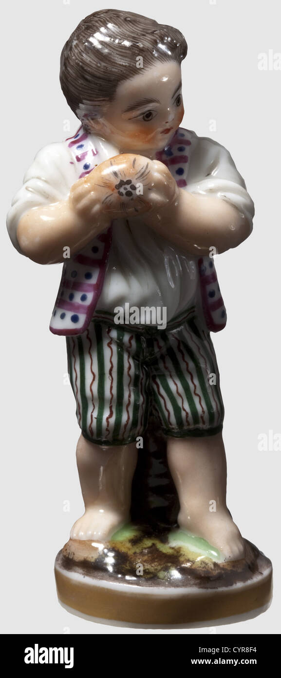 A boy's figure with Easter egg, Russian private manufactory, mid-19th century. Porcelain, glazed and finely - Stock Image