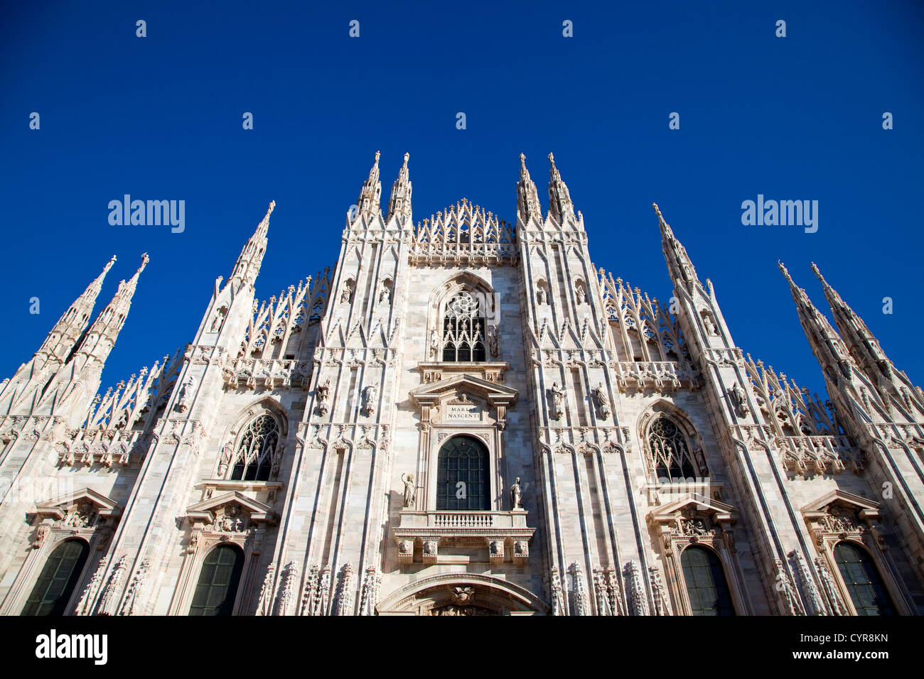 Duomo, gothic cathedral and blue sky in Milan, Milano, Italy, Italia - Stock Image