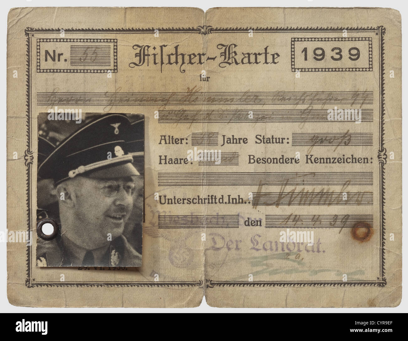 Heinrich Himmler, a fishing licence 1939 Rectangular licence on yellowish paperboard. The pre-printed form filled - Stock Image