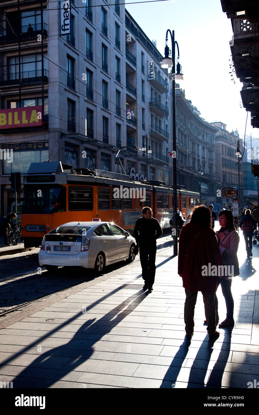 People walking and shopping in via Torino, famous central street in Milan, Milano, Italy, Italia - Stock Image