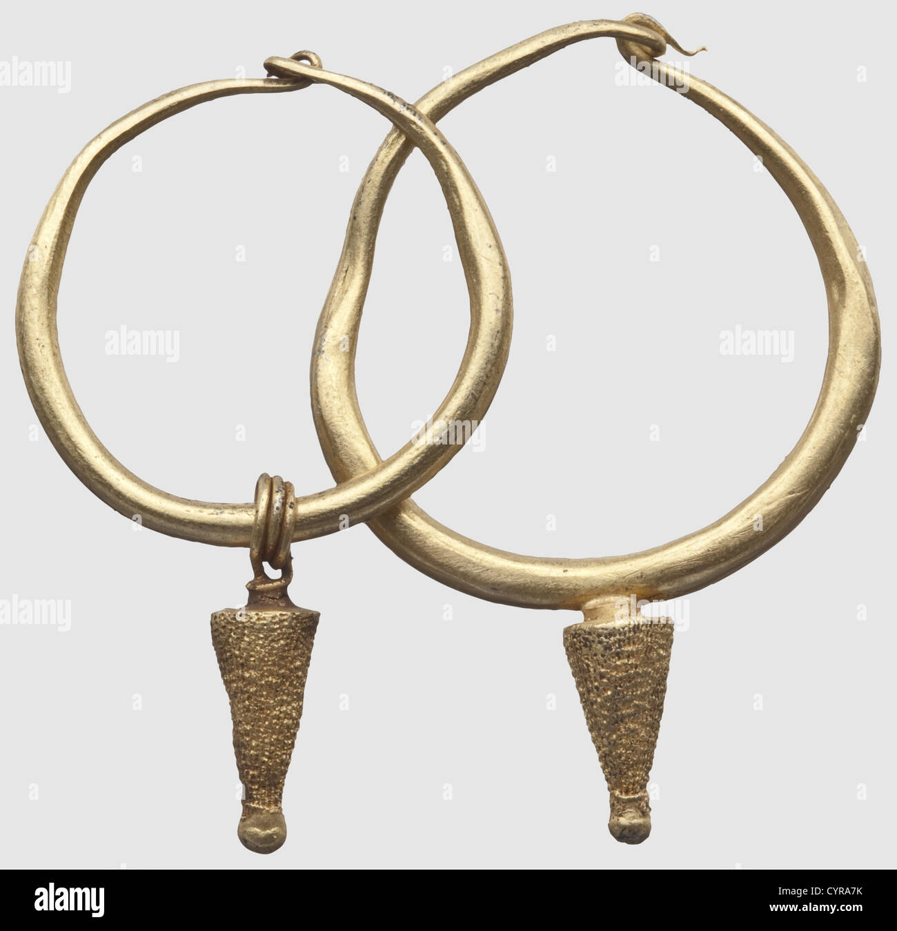 A Minoan pair of golden earrings, Crete, circa 1500 B.C. Earrings of different sizes with loop shaped closures. - Stock Image