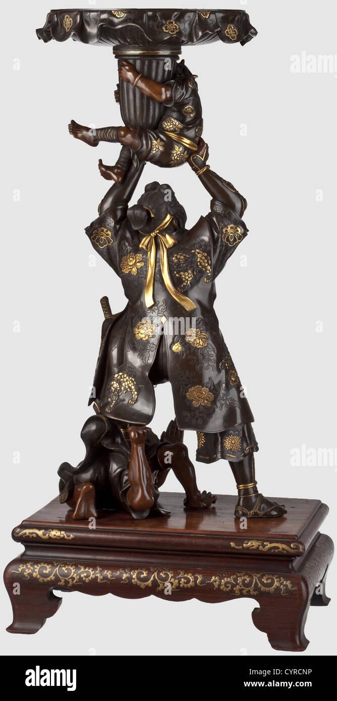 Benkei with two oni, Japan, Meiji period A three-piece bronze figure of the young Benkei in nigurome and akagane. - Stock Image