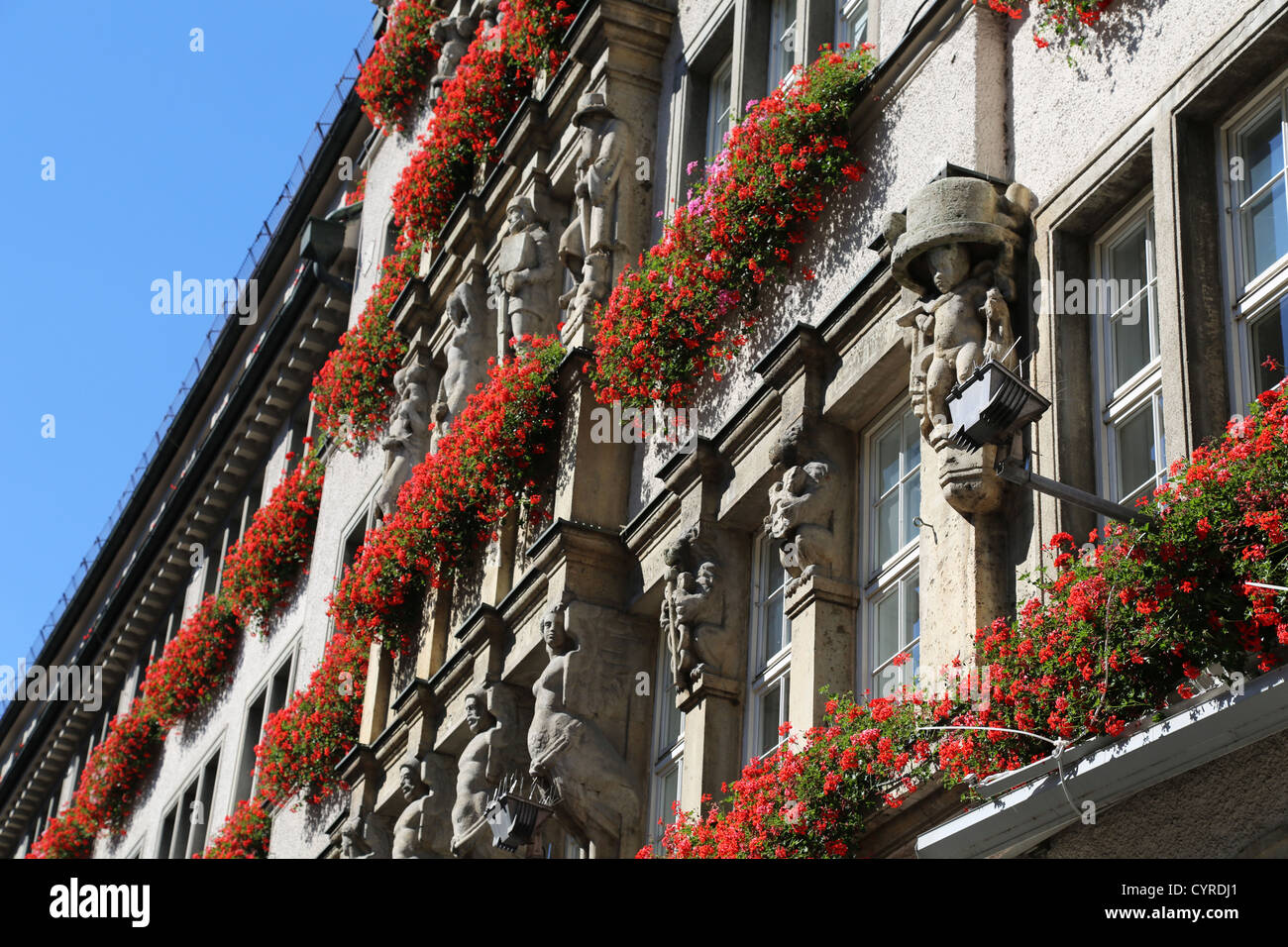 Geranium flowers on buildings in Munich, Germany Stock Photo
