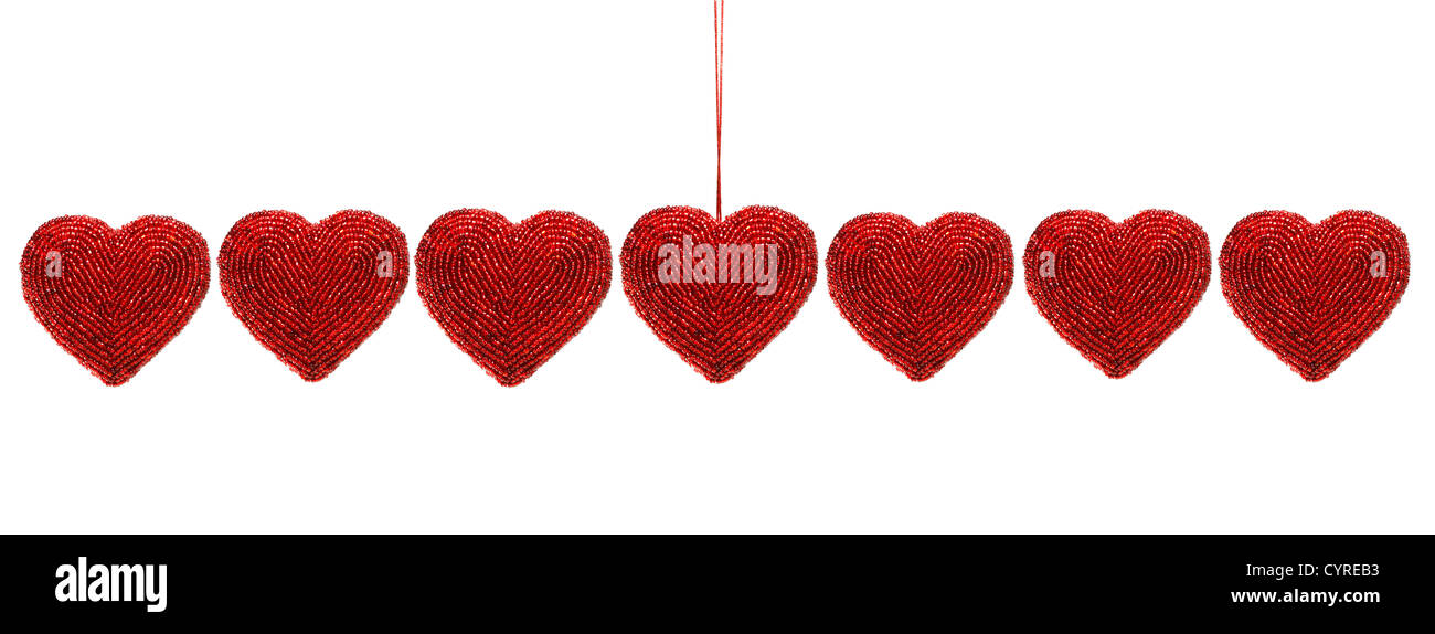Red beaded hearts isolated against white background - Stock Image