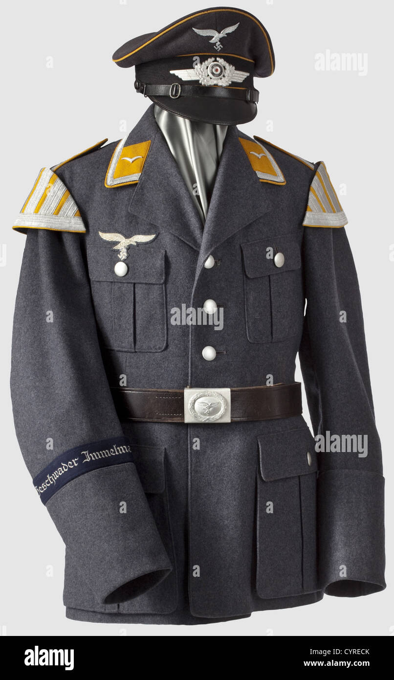 """A uniform ensemble for a musician, in the band of the dive bomber wing """"Immelmann"""" Visor cap made of Luftwaffe-blue Stock Photo"""