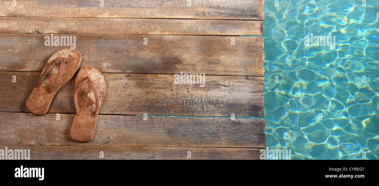Brown sandals on withered wood - Stock Image