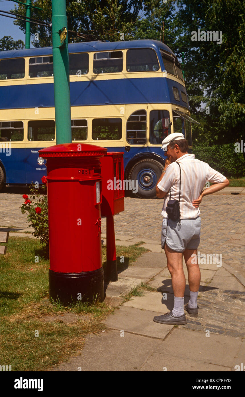 A visitor pauses to read the writing on a Royal Mail postal box while walking round the East Anglia Transport Museum, - Stock Image