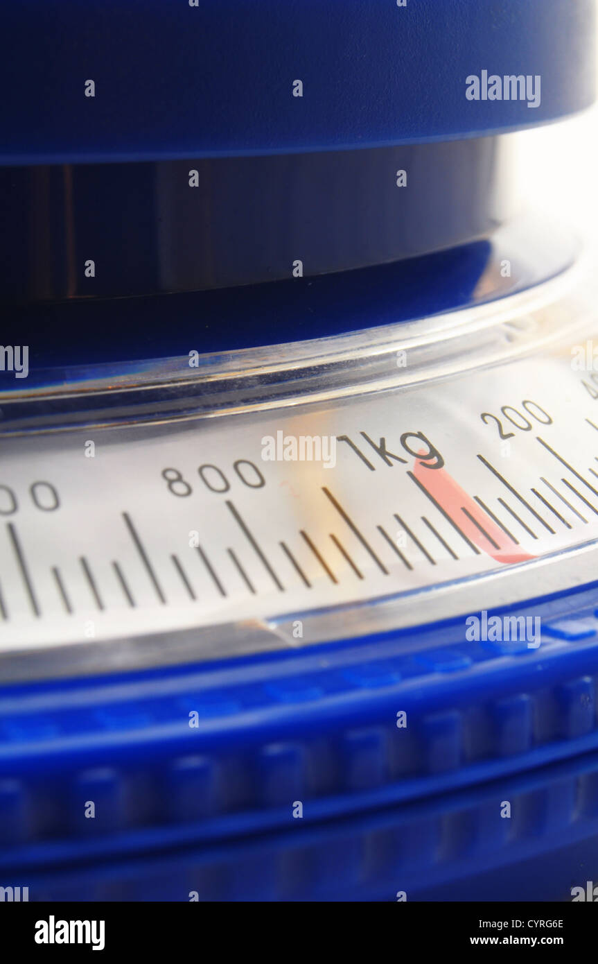 blue kitchen scales or balance showing cooking concept - Stock Image